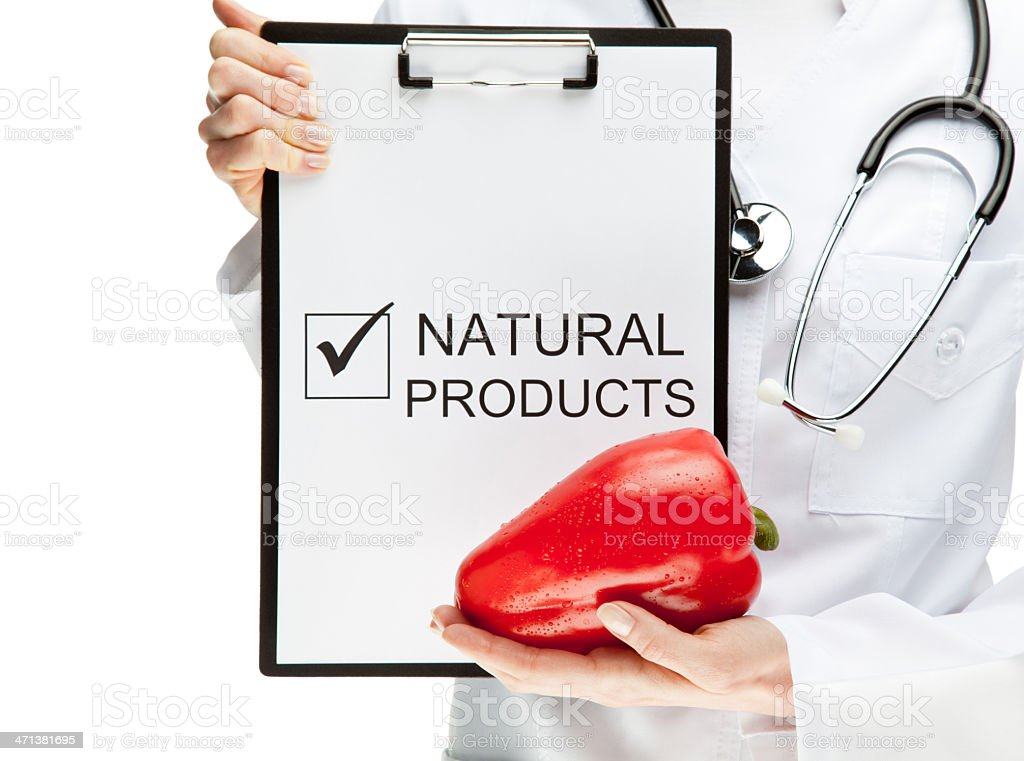 Doctor advising eating natural food royalty-free stock photo