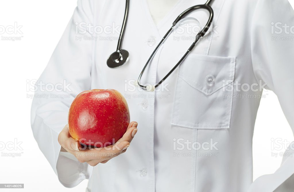 Doctor advising healthy food royalty-free stock photo