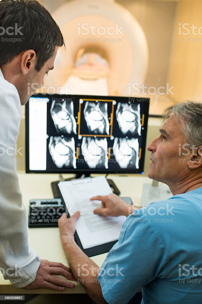 Doctor and a radiologist discussing. stock photo