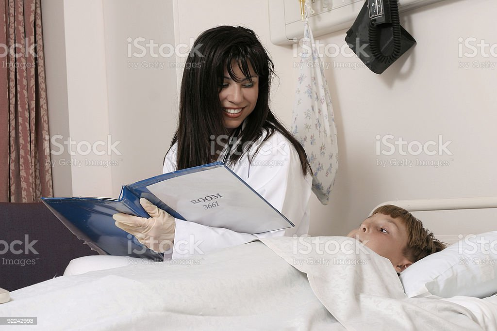 Doctor and child in ward royalty-free stock photo