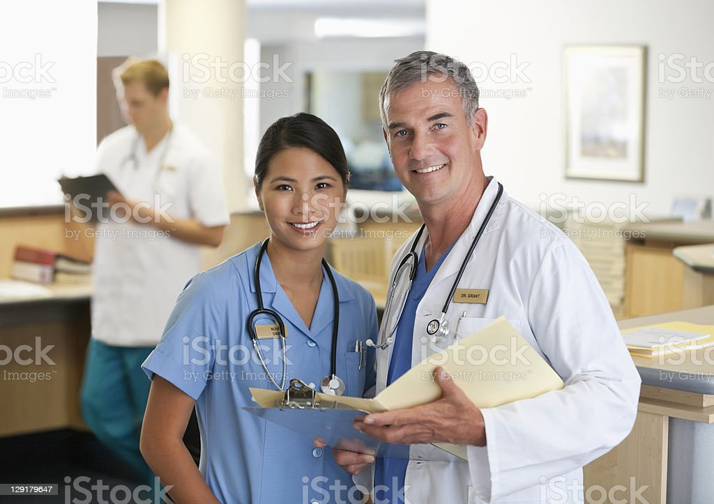 Doctor and female nurse in hospital royalty-free stock photo