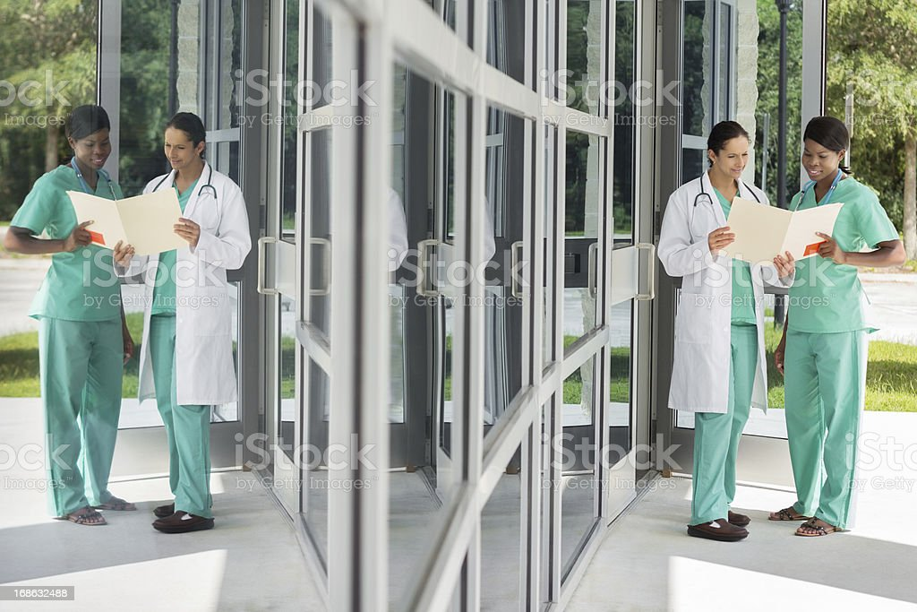 Doctor and her assistant outside a medical center royalty-free stock photo