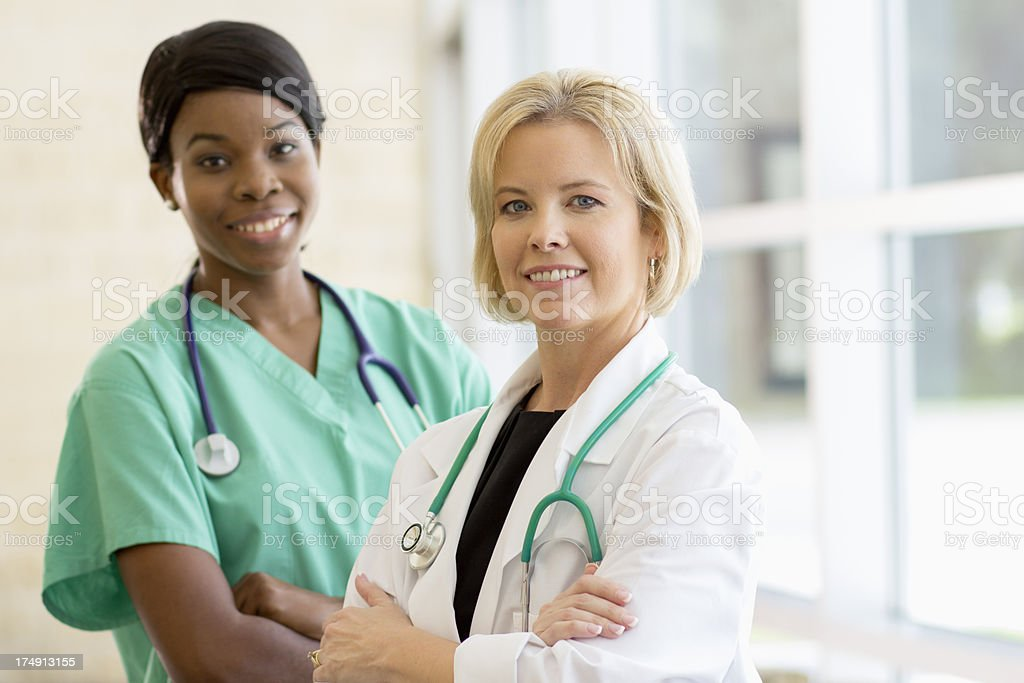 Doctor and her assistant stock photo