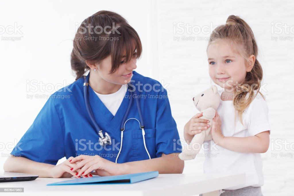 Doctor and her little patient stock photo