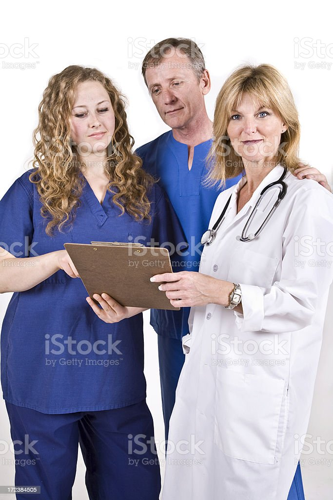 Doctor and Her Medical Staff. royalty-free stock photo