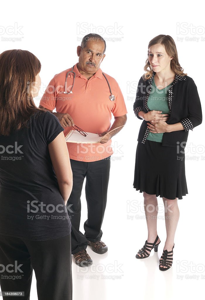 Doctor and Interpreter Talk to Patient About Stomach Ache royalty-free stock photo