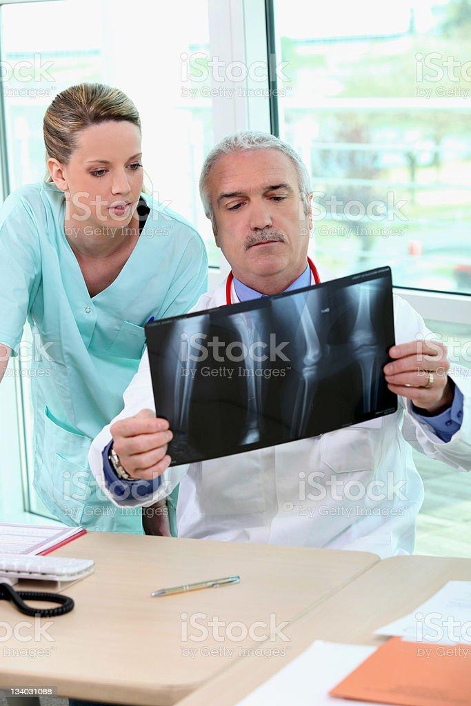 Doctor and nurse examining an xray royalty-free stock photo