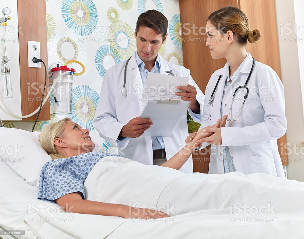 Doctor and nurse making rounds in hospital stock photo