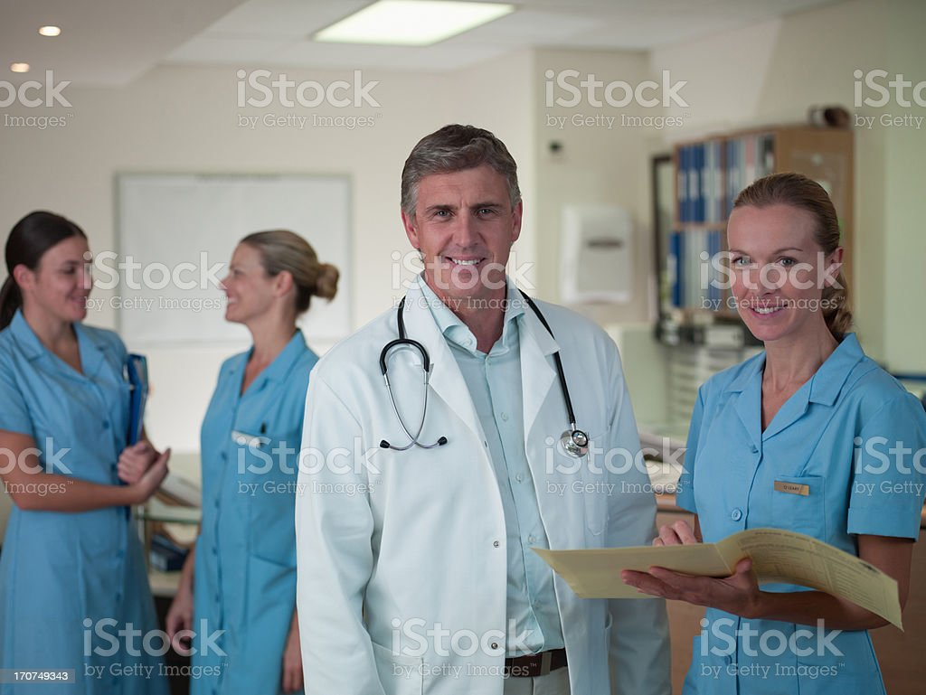 Doctor and nurse reviewing medical chart royalty-free stock photo