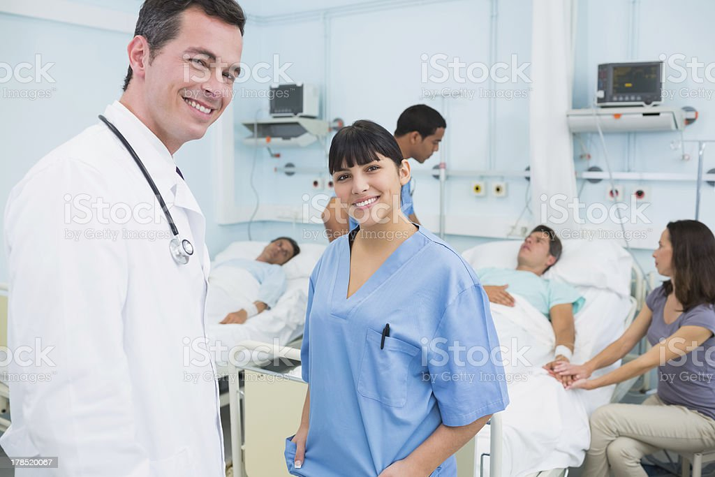 Doctor and nurse smiling royalty-free stock photo
