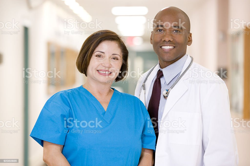 Doctor And Nurse Standing In Hospital Corridor royalty-free stock photo