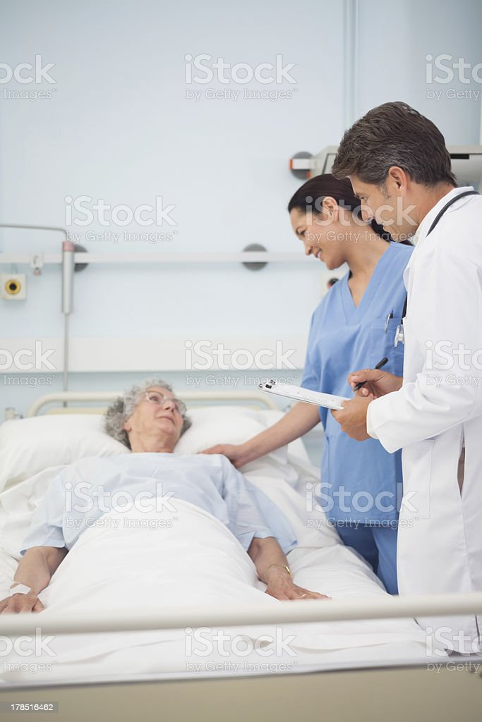 Doctor and nurse talking with a patient royalty-free stock photo