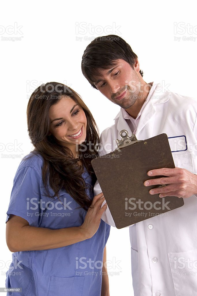 Doctor and Nurse with clipboard royalty-free stock photo
