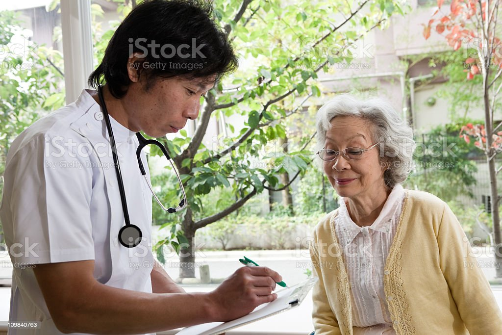 Doctor and old patient royalty-free stock photo