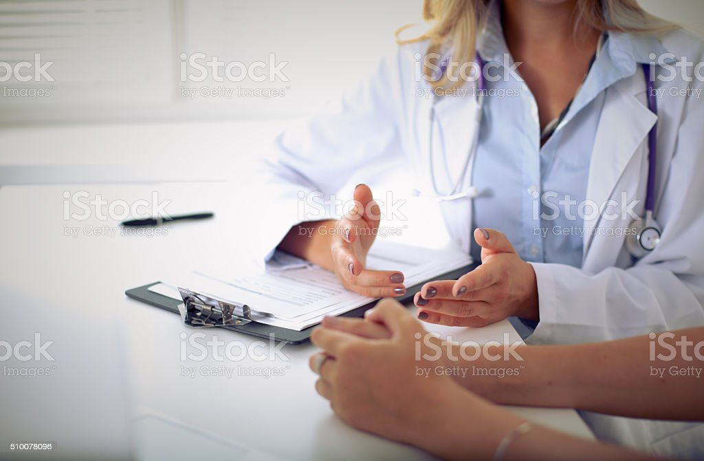 Doctor and patient are discussing something stock photo