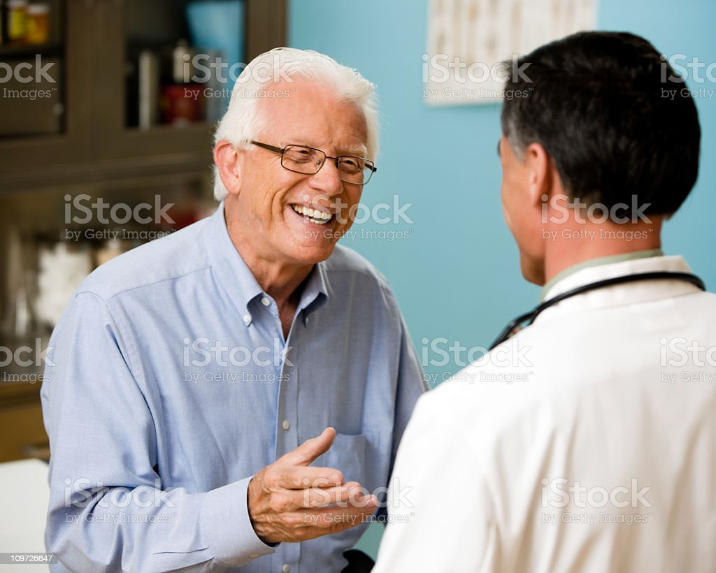 Doctor and Patient Consulting stock photo