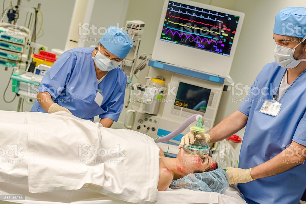 Doctor and patient in operating theatre stock photo