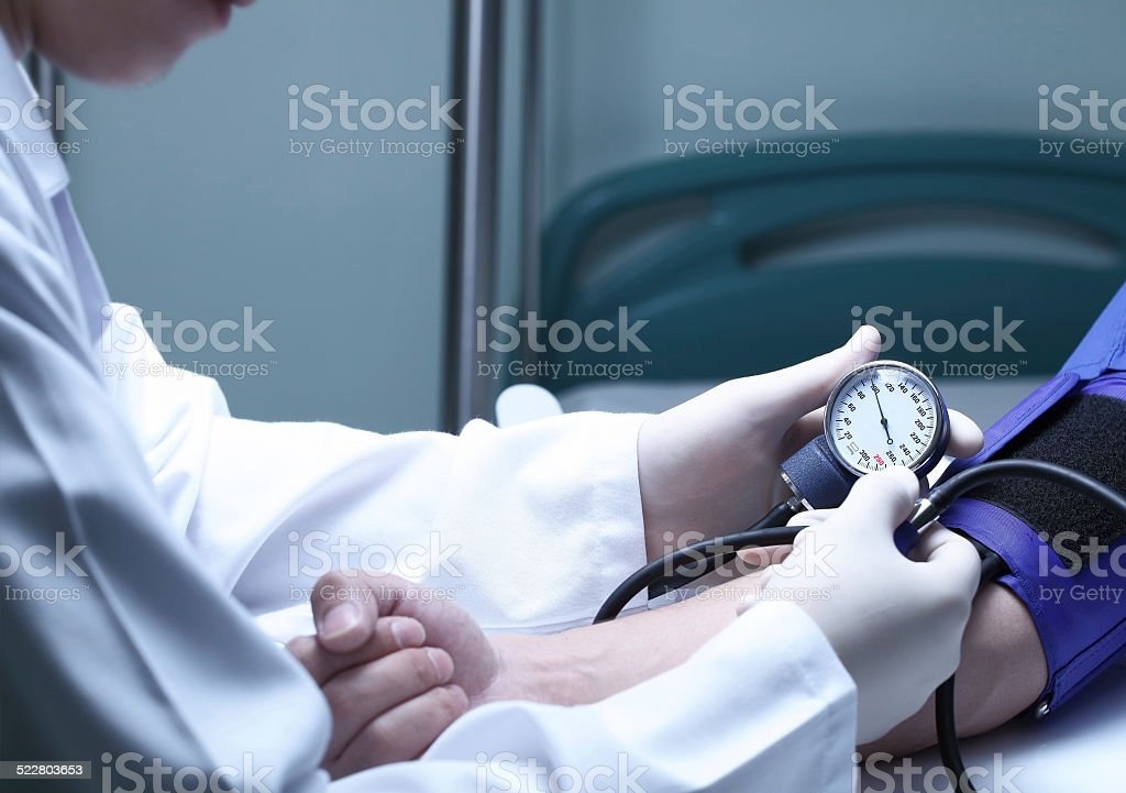 Doctor and patient. Measurement of blood pressure in a hospital stock photo