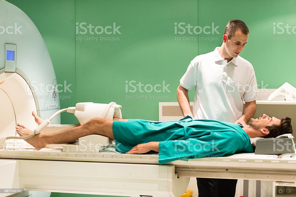 Doctor and patient using MRI scanner stock photo