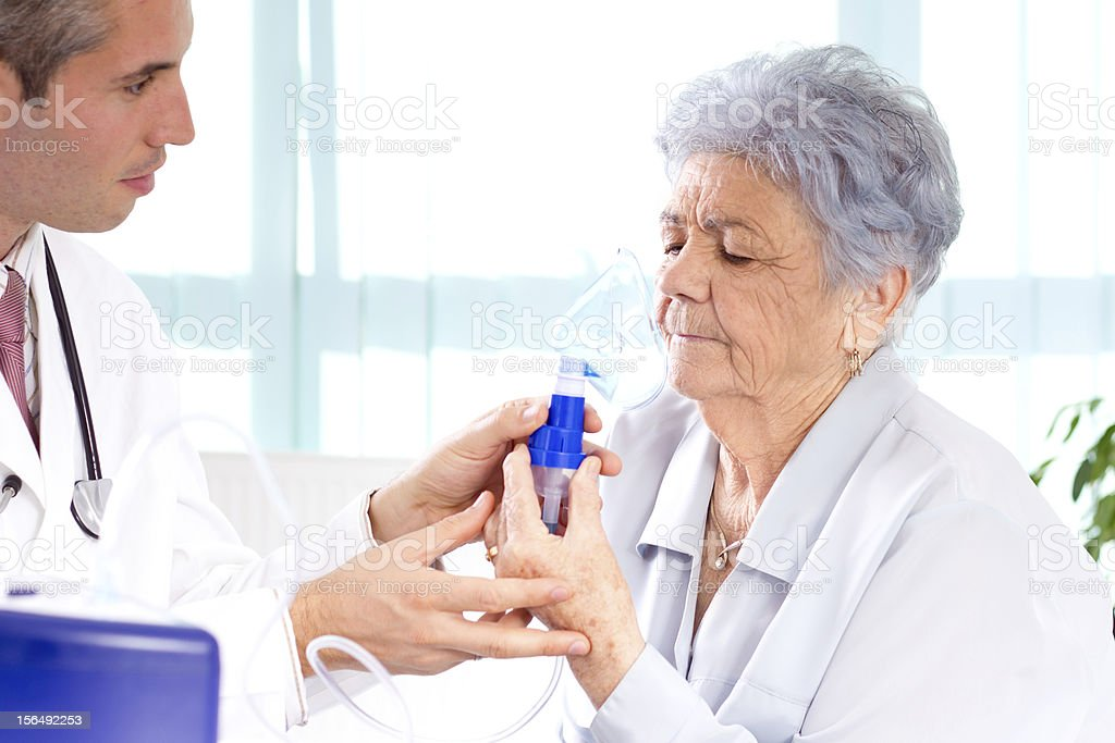Doctor and senior woman stock photo