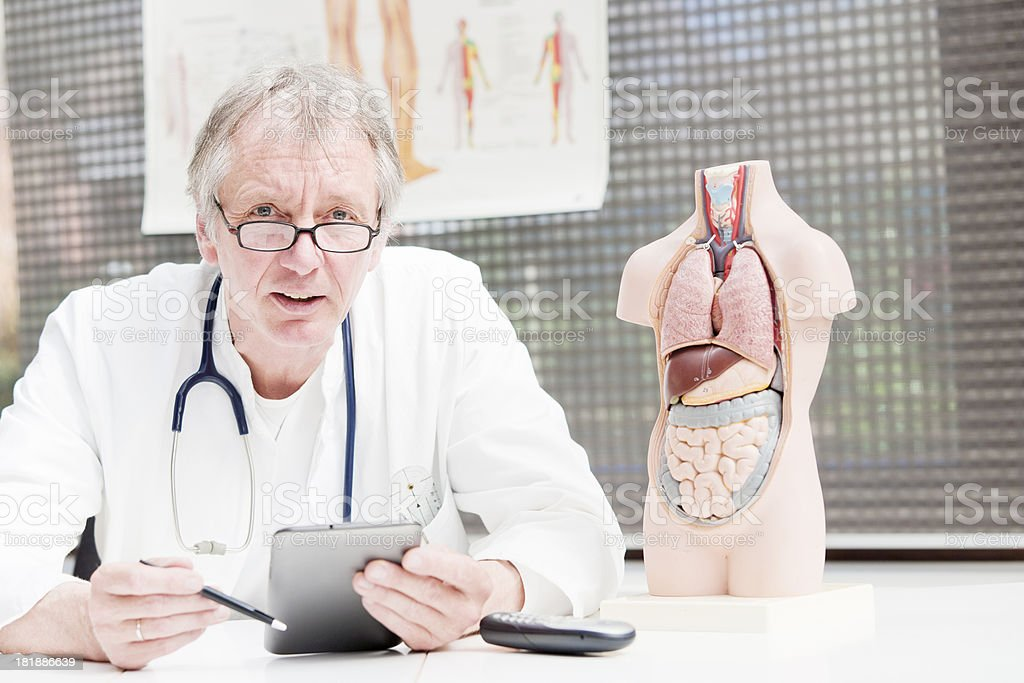 Doctor and tablet PC stock photo