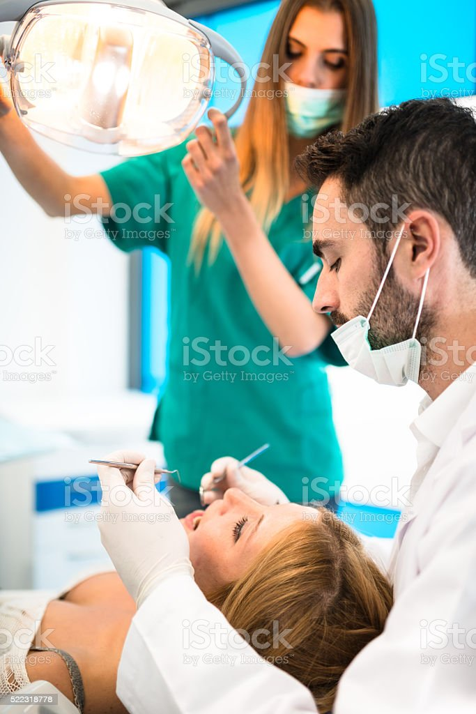 doctor and the assistant during a surgery stock photo