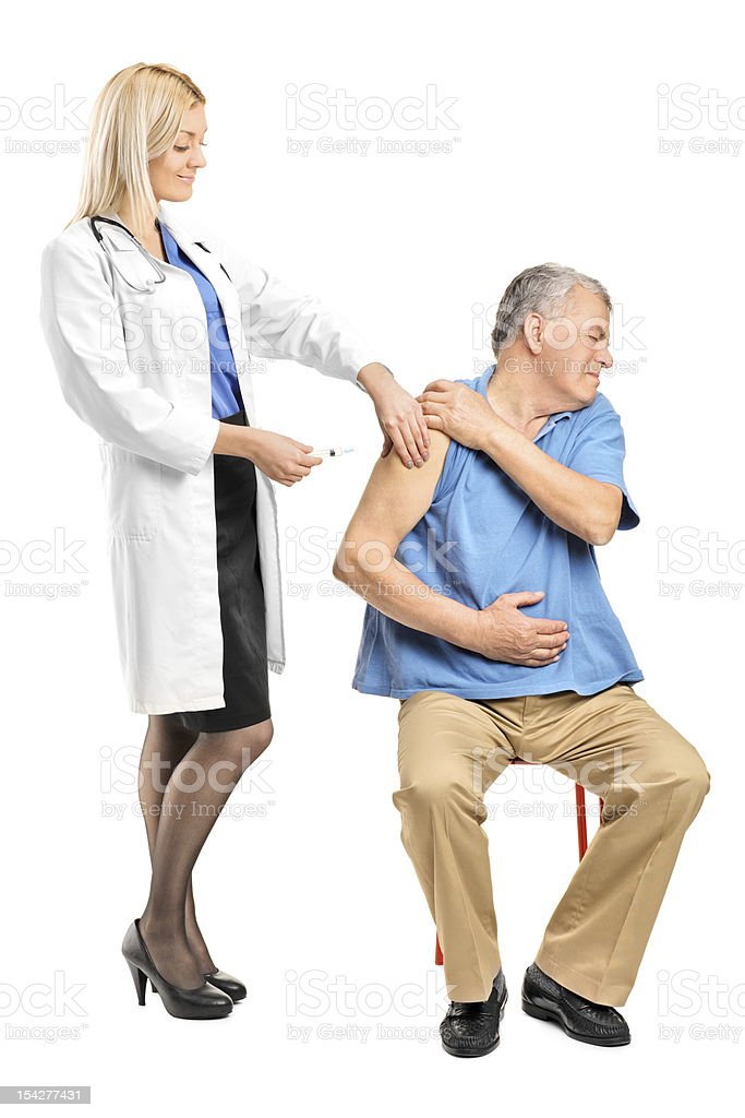 Doctor applying a syringe to an elderly man royalty-free stock photo