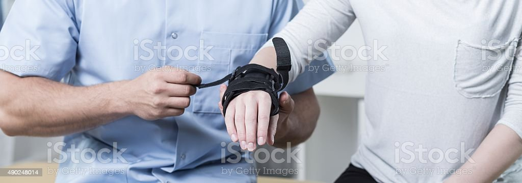 Doctor applying stabilizer stock photo