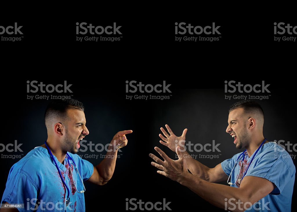 Doctor arguing with himself royalty-free stock photo