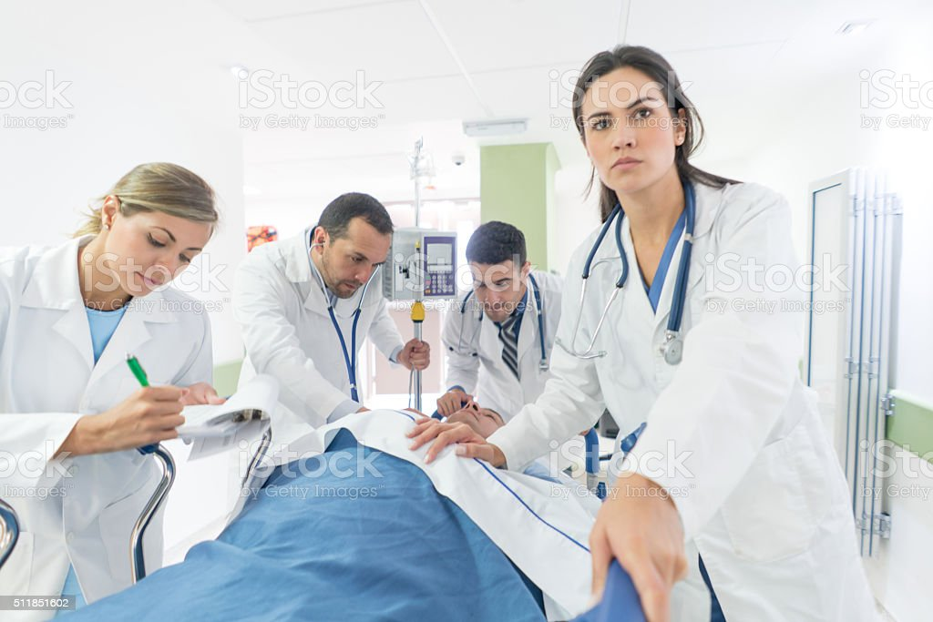 Doctor at the ER attending an emergency stock photo