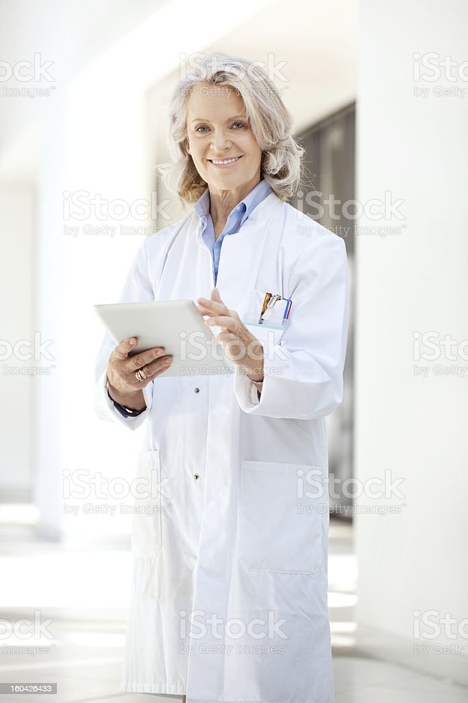 Doctor at the hospital with digital tablet stock photo
