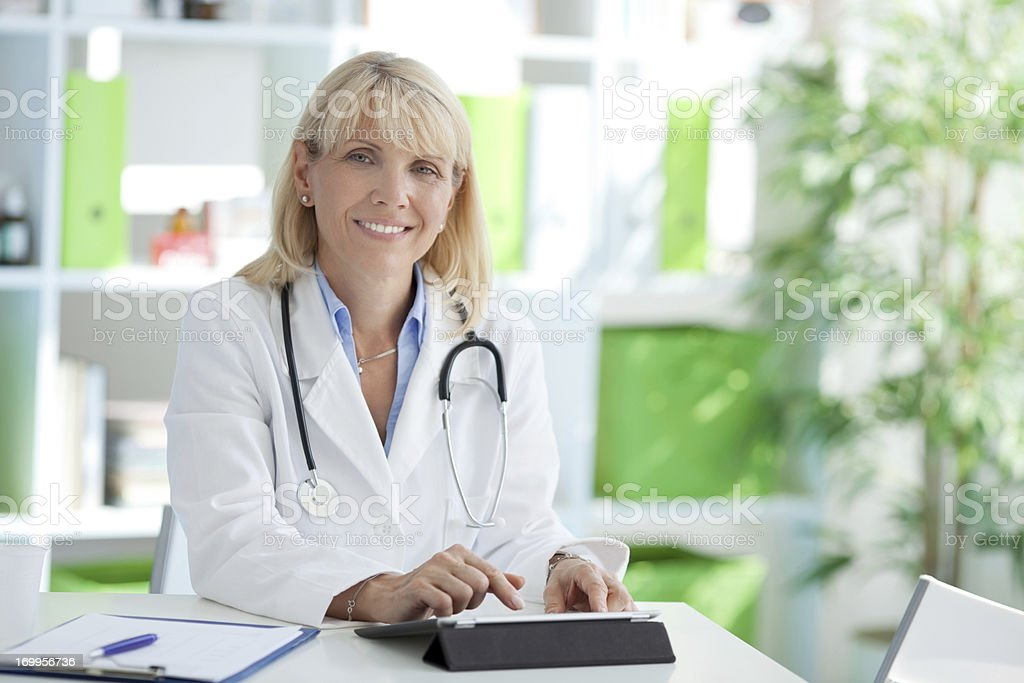 Doctor at the office. stock photo