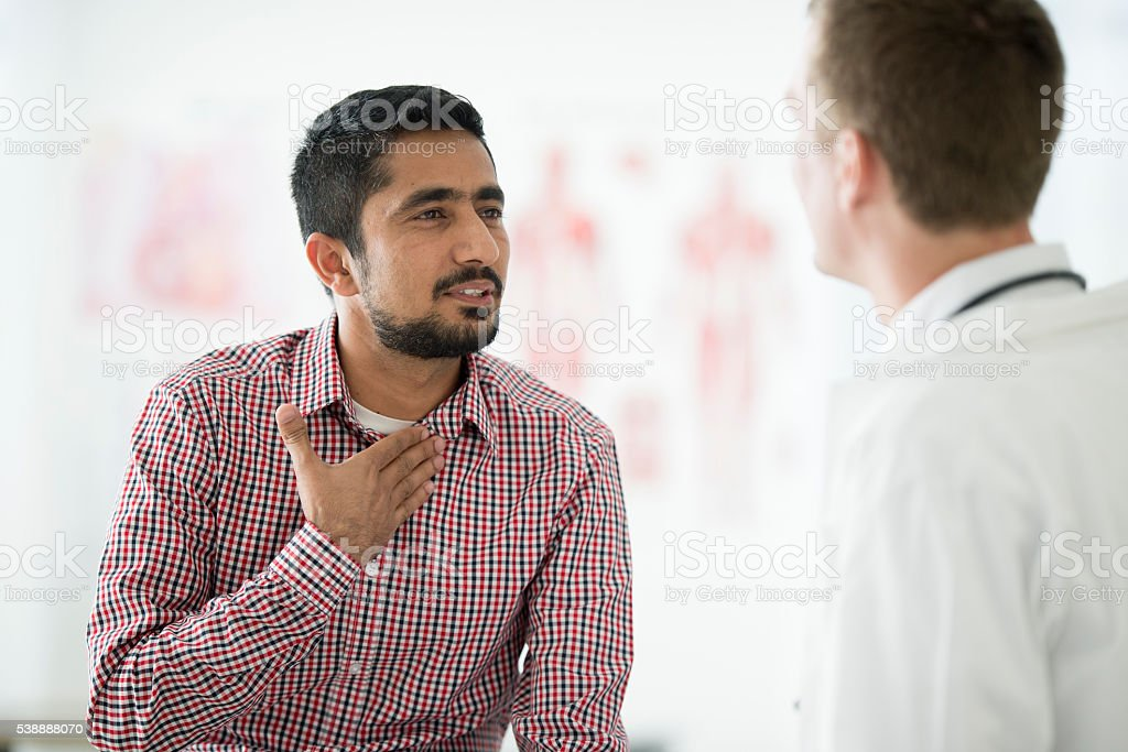 Doctor Checking a Man Cough stock photo