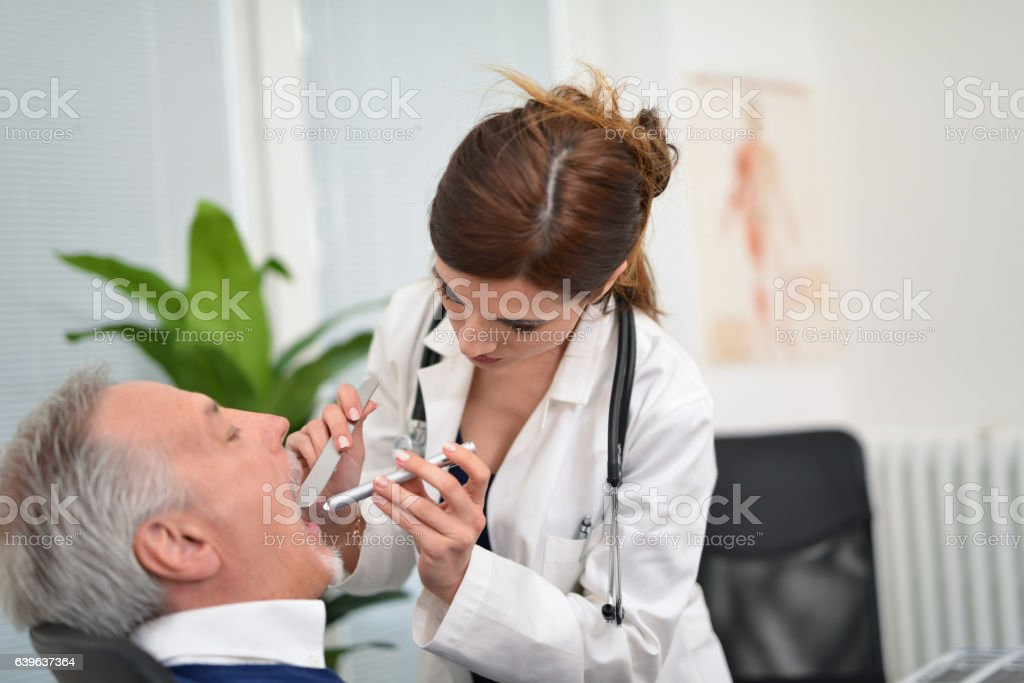 Doctor checking a patient stock photo
