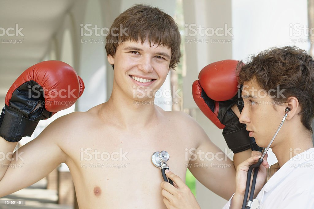 Doctor checking a smiling boxer royalty-free stock photo