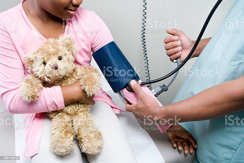 Doctor checking girl stock photo