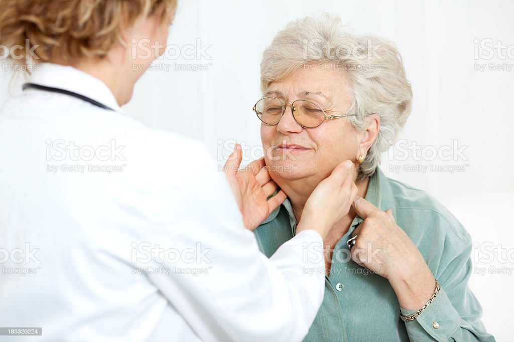 Doctor Checking Glands stock photo