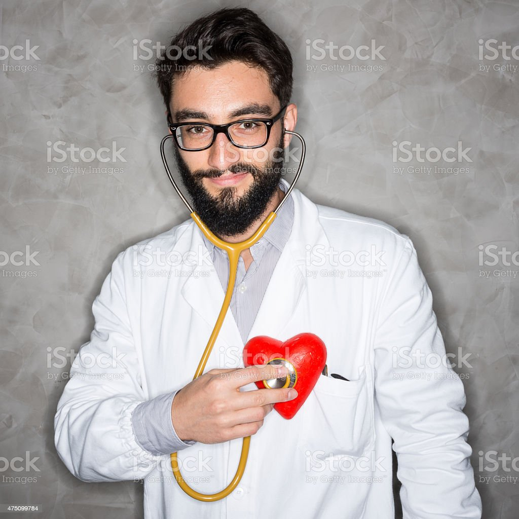 Doctor checking his own heartbeat stock photo