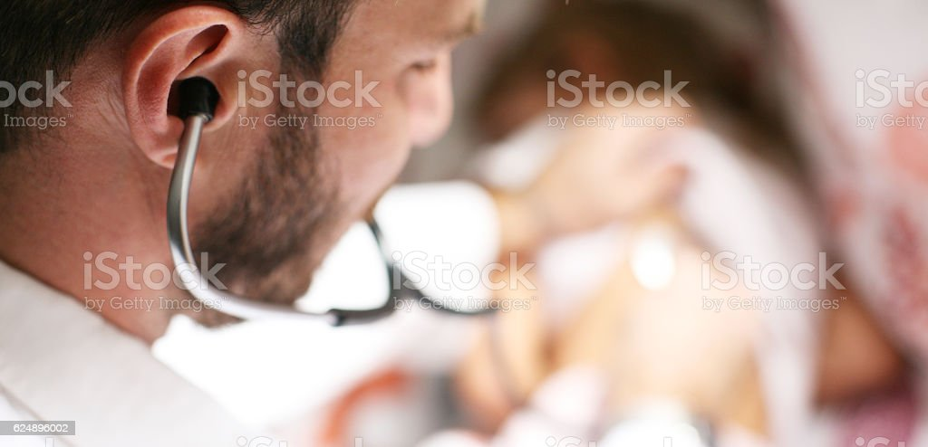 Doctor checking lungs of his patient. stock photo