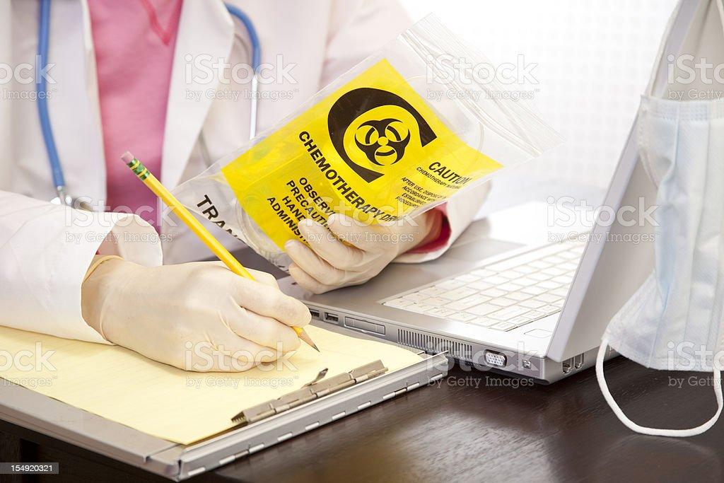 Doctor checking medication. Cancer, leukemia patient medicine. Laptop. stock photo