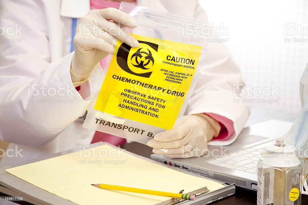 Doctor checking medication used by leukemia patient royalty-free stock photo