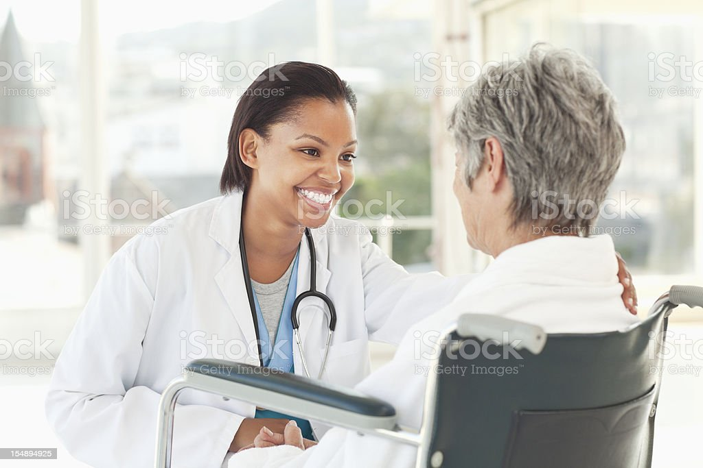 Doctor Checking on an Elderly Patient royalty-free stock photo