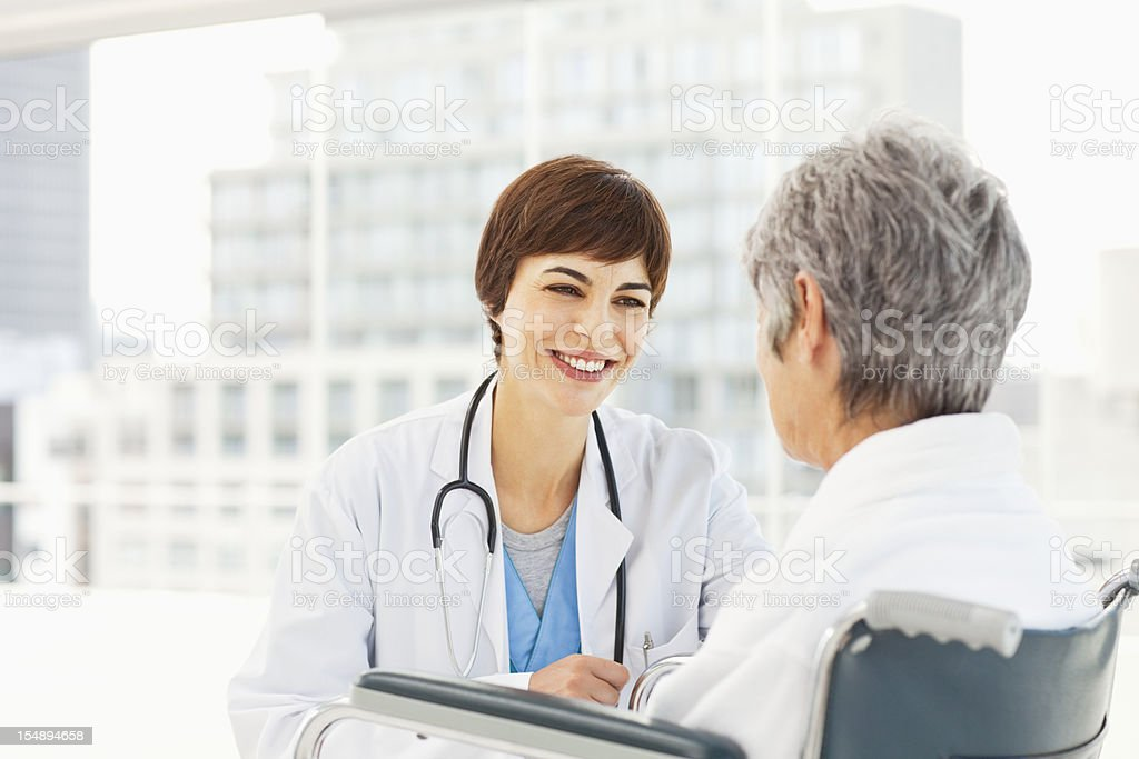 Doctor Checking on Her Patient royalty-free stock photo
