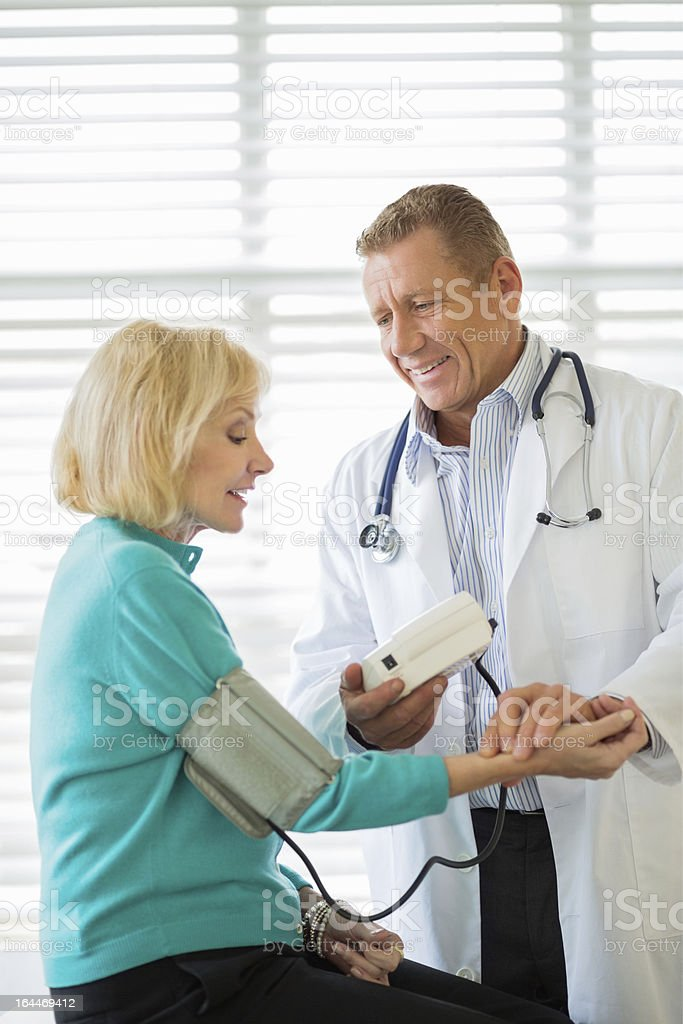 Doctor Checking Patient's Blood Pressure royalty-free stock photo