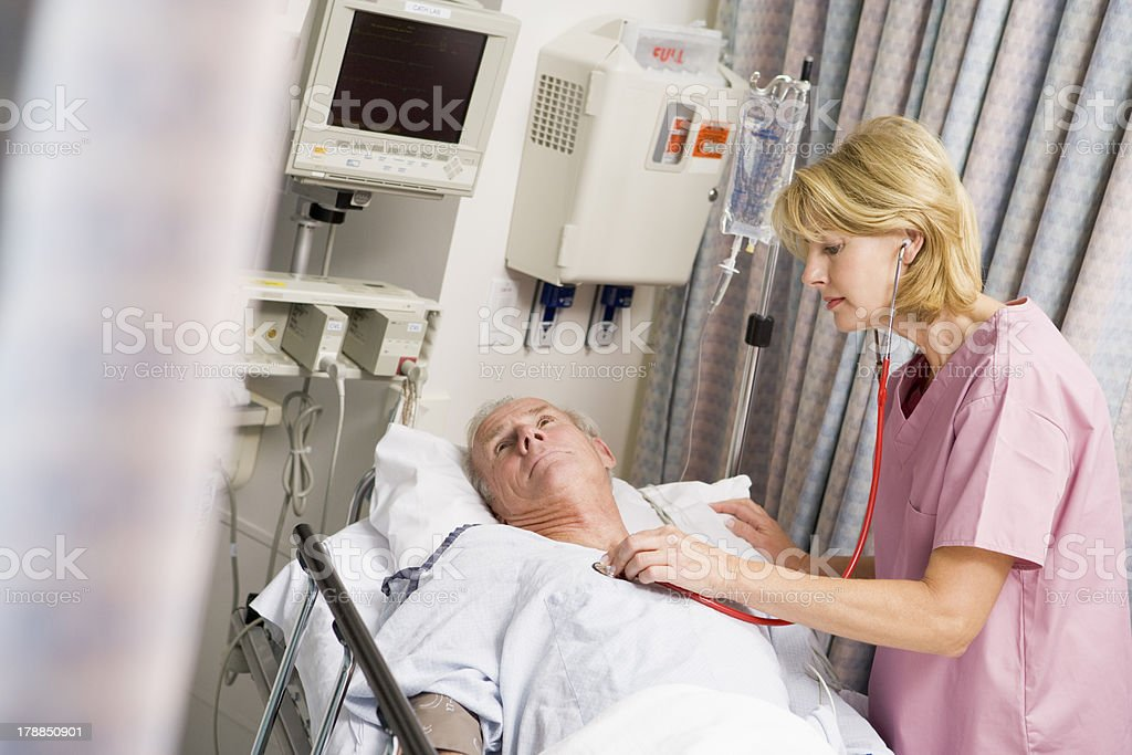 Doctor Checking Patient's Heartbeat stock photo