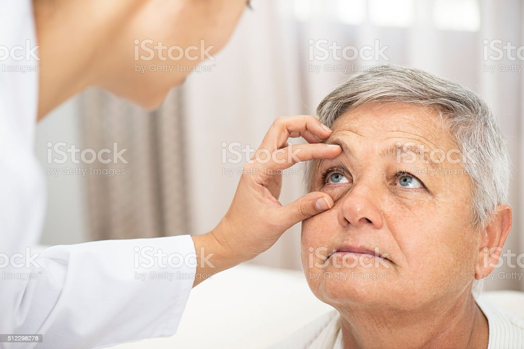 Doctor checking patient's ocular health stock photo