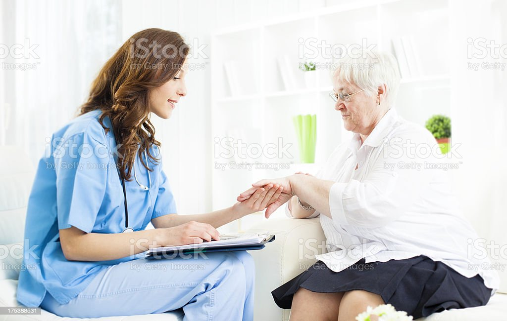 Doctor Checking Psoriasis on Senior Woman patient hand. stock photo