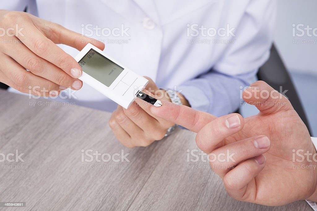 Doctor Checking Sugar Level stock photo