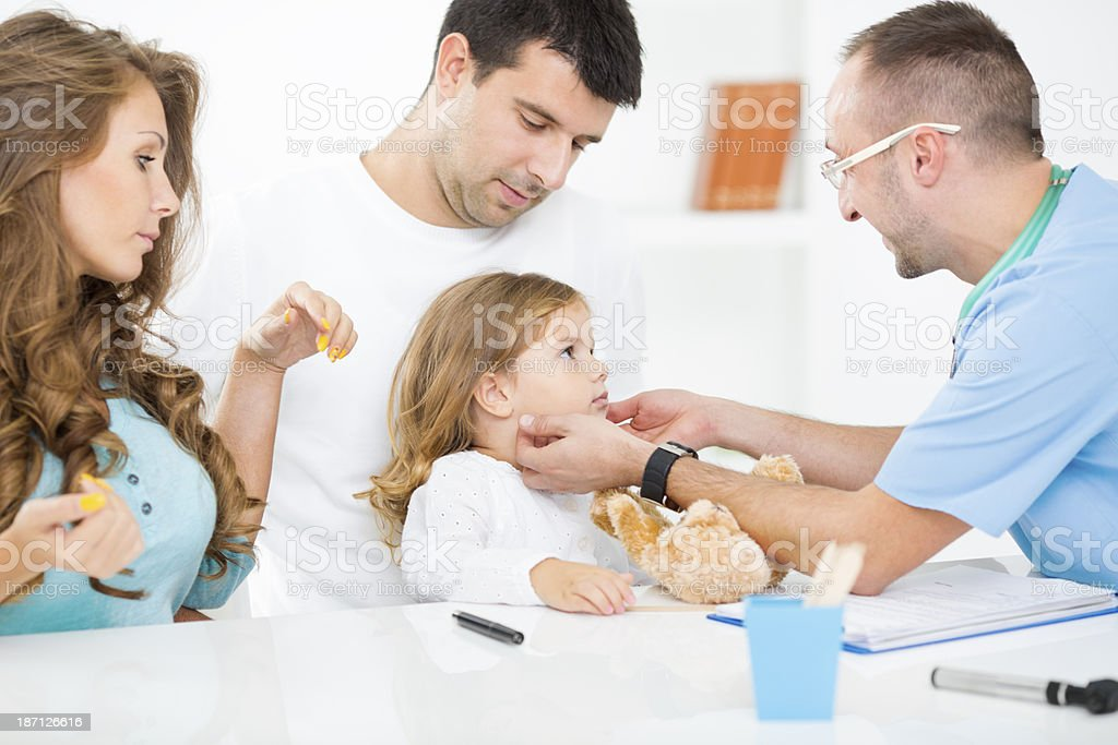Doctor checking swollen glands of little girl. royalty-free stock photo