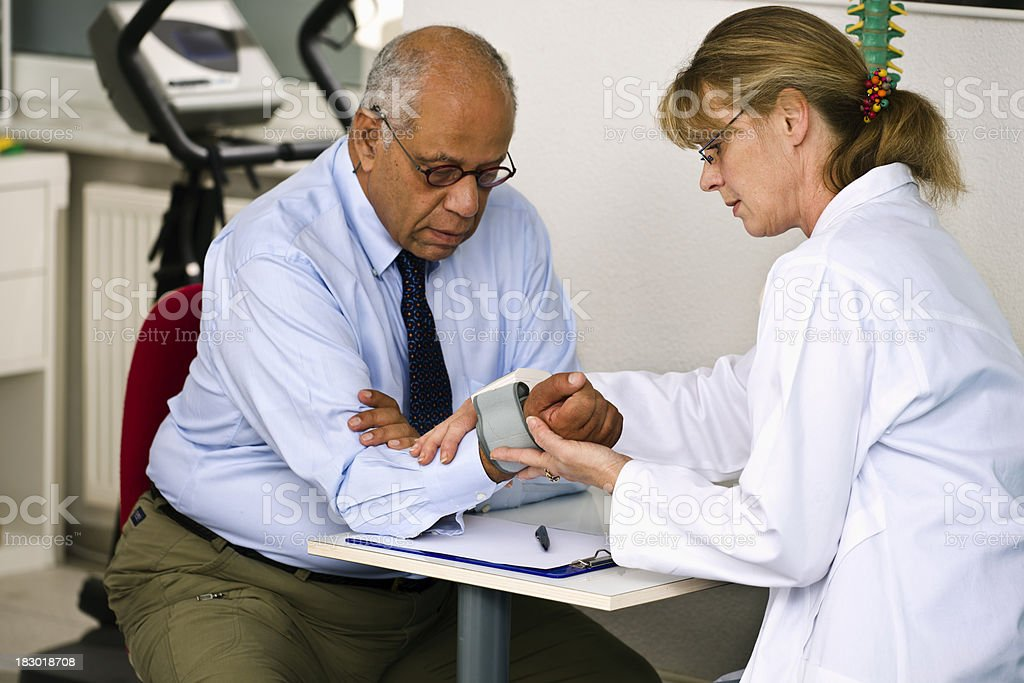 Doctor Checking the Blood Pressure of Her Patient royalty-free stock photo